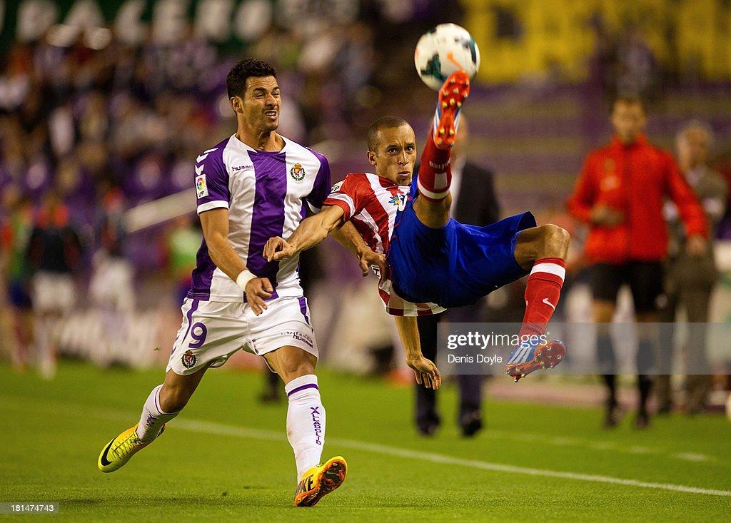 Joao Miranda (R) of Club Atletico de Madrid kicks the ball beside Javi Guerra of Real Valladolid CF during the La Liga match between Real Valladolid CF and Club Atletico de Madrid at Estadio Jose Zorilla on September 21, 2013 in Valladolid, Spain.