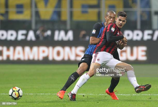Joao Miranda of FC Internazionale competes for the ball with Andre Silva of AC Milan during the Serie A match between FC Internazionale and AC Milan...