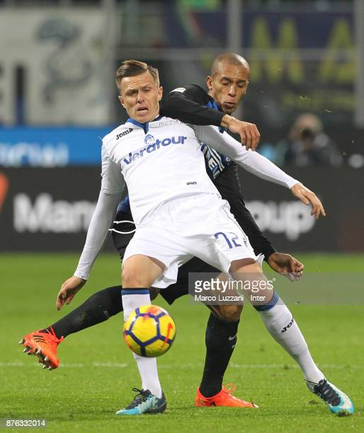 Joao Miranda of FC Internazionale competes for the ball with Josip Ilicic of Atalanta BC during the Serie A match between FC Internazionale and...