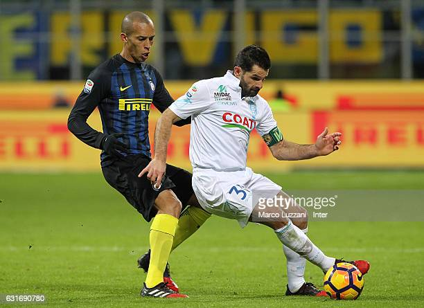 Joao Miranda of FC Internazionale competes for the ball with Sergio Pellissier of AC ChievoVerona during the Serie A match between FC Internazionale...