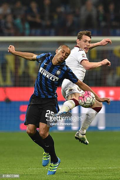 Joao Miranda of FC Internazionale Milano clashes with Andrea Belotti of Torino FC during the Serie A match between FC Internazionale and Torino FC...