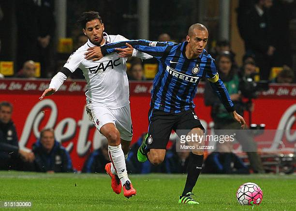 Joao Miranda of FC Internazionale Milano competes for the ball with Saphir Sliti Taider of Bologna FC during the Serie A match between FC...