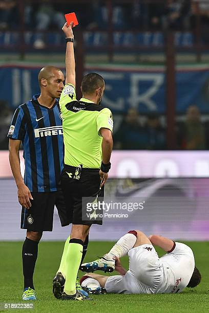 Joao Miranda of FC Internazionale Milano receives the yellow card from referee Marco Guida during the Serie A match between FC Internazionale and...