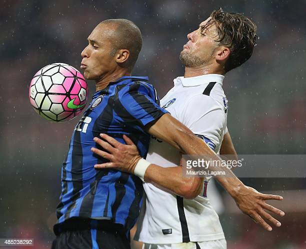 Joao Miranda of Inter competes for the ball with Guglielmo Stendardo of Atalanta during the Serie A match between FC Internazionale Milano and...