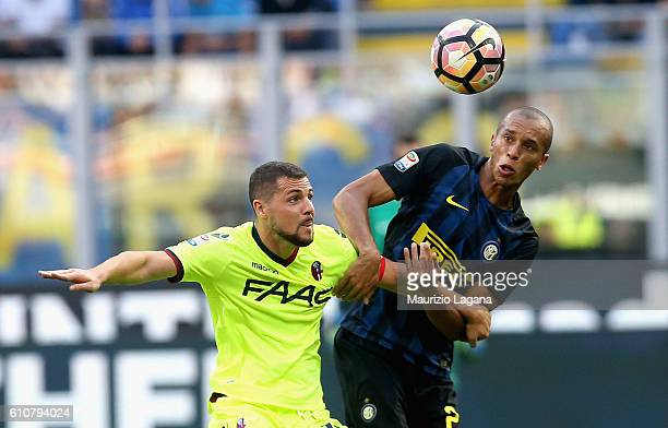 Joao Miranda of Inter competes for the ball with Mattia Destro of Bologna during the Serie A match between FC Internazionale and Bologna FC at Stadio...
