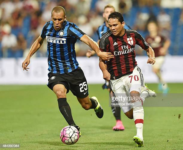 Joao Miranda of Internazionale and Carlos Bacca Ahumada of Milan in action during the TIM preseason tournament match between AC Milan and FC...
