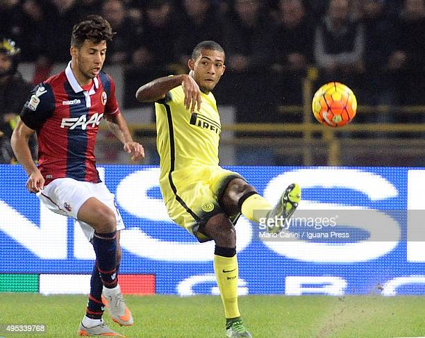 Joao Miranda of Internazionale Milano kicks the ball past Saphir Taider of Bologna FC during the Serie A match between Bologna FC and FC...