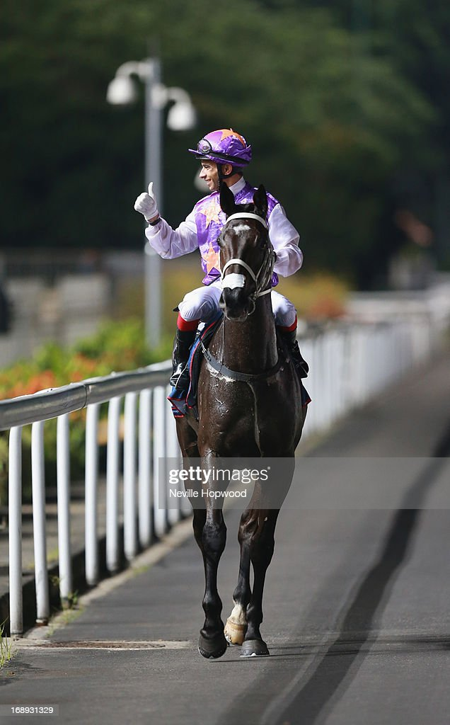 Joao Moreira gives a thumbs up on War Affair after winning the Group 2 Aushorse Golden Horseshoe during Singapore racing at Kranji on May 17, 2013 in Singapore.