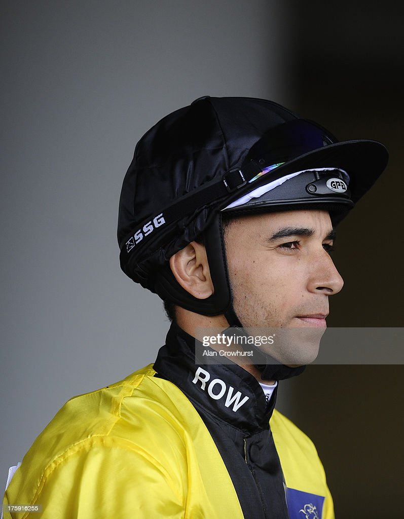 Joao Moreira poses at Ascot racecourse on August 10, 2013 in Ascot, England.