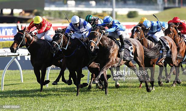 Joao Moreira rides He's Your Man to win the Epsom Group 1 during Sydney Racing at Royal Randwick Racecourse on October 4 2014 in Sydney Australia