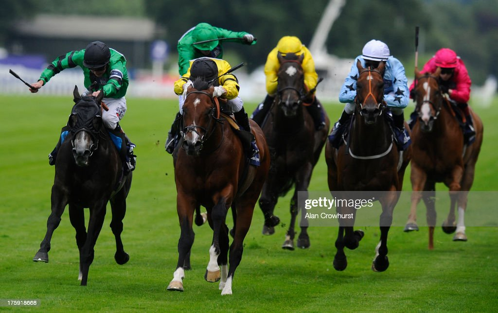 Joao Moreira riding Ahtoug win The Barclays Shergar Cup Dash Stakes at Ascot racecourse on August 10, 2013 in Ascot, England.