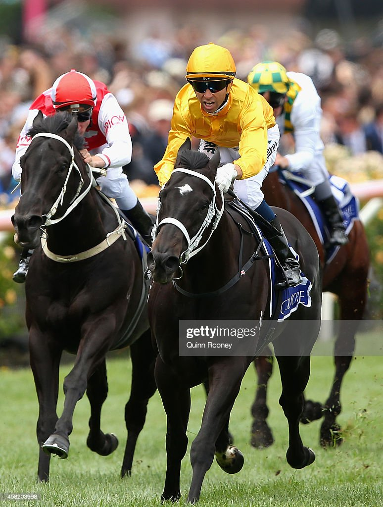 Joao Moreira riding Brazen Beau leads the field across the line to win the Coolmore Stud Stakes on Derby Day at Flemington Racecourse on November 1...
