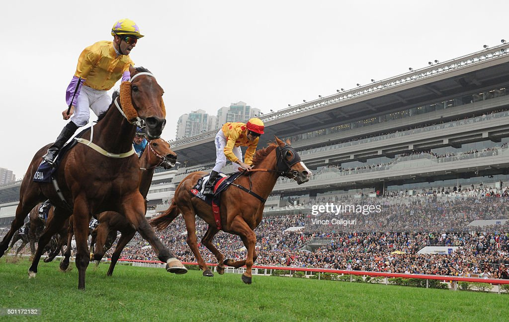 Joao Moreira riding Peniaphobia of Hong Kong defeats <a gi-track='captionPersonalityLinkClicked' href=/galleries/search?phrase=Christophe+Soumillon&family=editorial&specificpeople=453308 ng-click='$event.stopPropagation()'>Christophe Soumillon</a> riding Gold-Fun in Race 5, The Longines Hong Kong Sprint during the Hong Kong International Races at Sha Tin racecourse on December 13, 2015 in Hong Kong, Hong Kong.