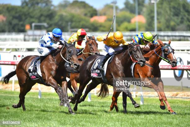 Joao Moreira riding Savanna Amour defeats Steven Parnham riding Ellicazoom and Mark Zahra riding Oregan's Day in Race 4 Armanasco Stakes during...