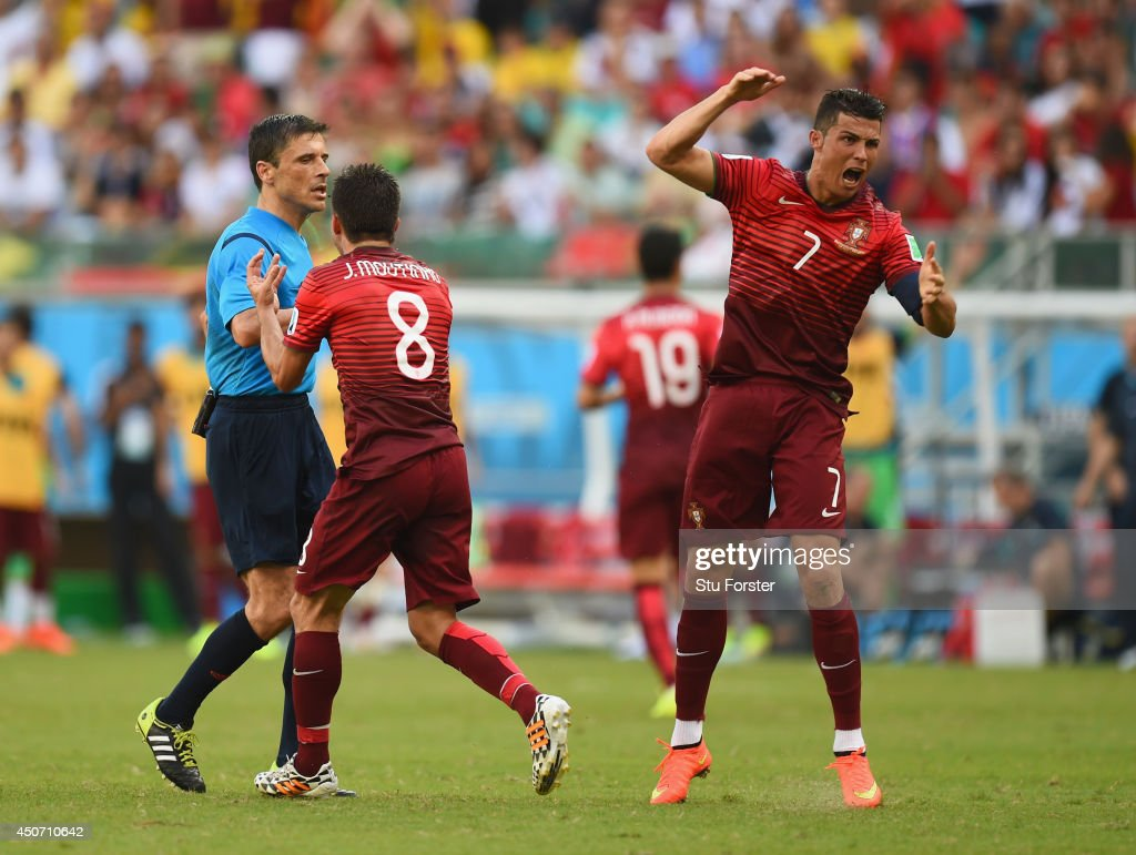 Joao Moutinho (C) and Cristiano Ronaldo of Portugal (R) react toward referee Milorad Mazic during the 2014 FIFA World Cup Brazil Group G match between Germany and Portugal at Arena Fonte Nova on June 16, 2014 in Salvador, Brazil.