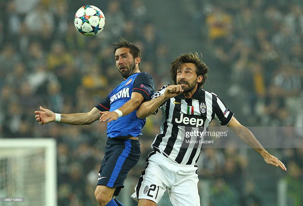 Joao Moutinho of AS Monaco FC competes for the ball with Andrea Pirlo of Juventus FC during the UEFA Champions League Quarter Final First Leg match...