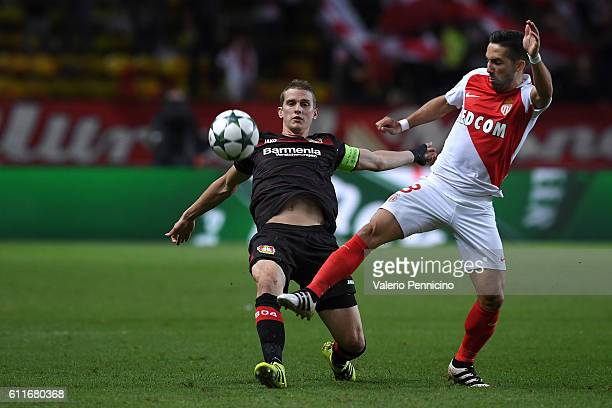 Joao Moutinho of AS Monaco FC tackles Lars Bender of Bayer 04 Leverkusen during the UEFA Champions League Group E match between AS Monaco FC and...