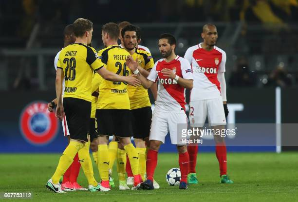 Joao Moutinho of AS Monaco shakes hands with Matthias Ginter of Borussia Dortmund following the UEFA Champions League Quarter Final first leg match...