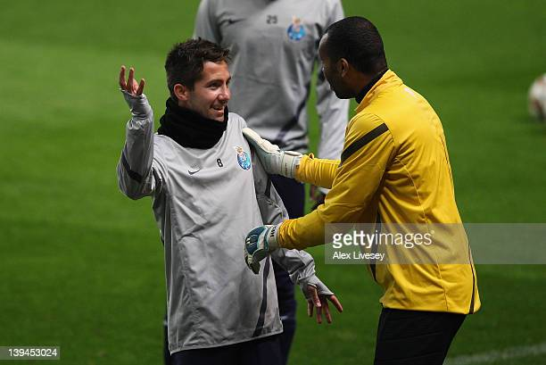 Joao Moutinho of FC Porto shares a joke with Helton during a training session ahead of their UEFA Europa League round of 32 second leg match between...