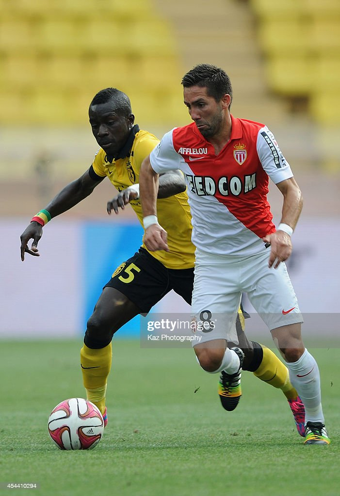 Joao Moutinho of Monaco and Idrissa Gueye of Lille compete for the ball during the French Ligue 1 match between AS Monaco FC and LOSC Lille at Louis...