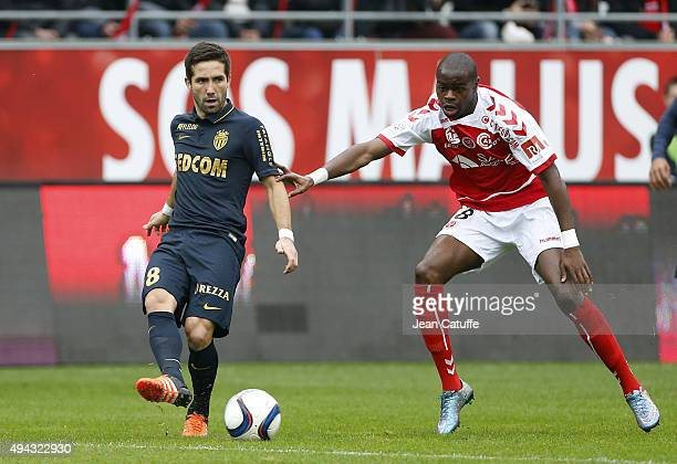Joao Moutinho of Monaco and Prince Oniangue of Stade de Reims in action during the French Ligue 1 match between Stade de Reims and AS Monaco at Stade...
