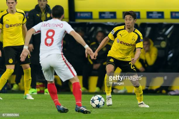 Joao Moutinho of Monaco and Shinji Kagawa of Dortmund battle for the ball during the UEFA Champions League Quarter Final First Leg match between...
