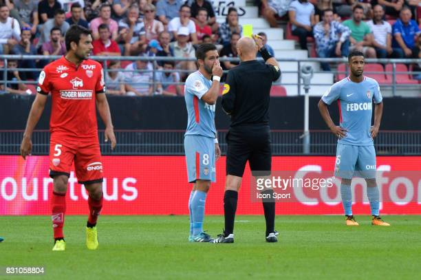 Joao Moutinho of Monaco receives a yellow card during the Ligue 1 match between Dijon FCO and AS Monaco at Stade Gaston Gerard on August 13 2017 in...
