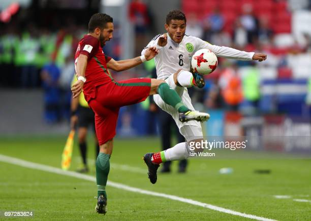 Joao Moutinho of Portugal and Jonathan Dos Santos of Mexico battle for possession during the FIFA Confederations Cup Russia 2017 Group A match...