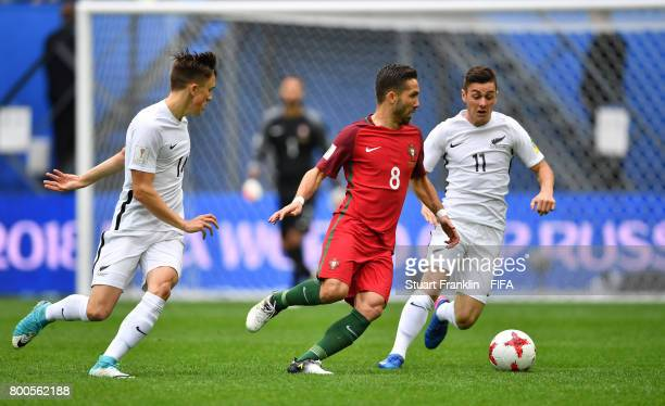 Joao Moutinho of Portugal attempts to get past Marco Rojas of New Zealand during the FIFA Confederations Cup Russia 2017 Group A match between New...