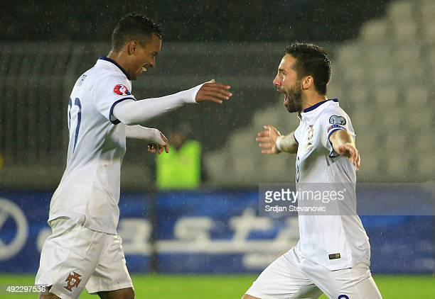Joao Moutinho of Portugal celebrate scoring a goal with the Nani during the Euro 2016 qualifying football match between Serbia and Portugal at the...