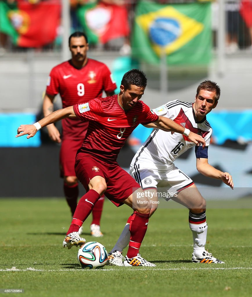 Joao Moutinho of Portugal controls the ball against <a gi-track='captionPersonalityLinkClicked' href=/galleries/search?phrase=Philipp+Lahm&family=editorial&specificpeople=483746 ng-click='$event.stopPropagation()'>Philipp Lahm</a> of Germany during the 2014 FIFA World Cup Brazil Group G match between Germany and Portugal at Arena Fonte Nova on June 16, 2014 in Salvador, Brazil.