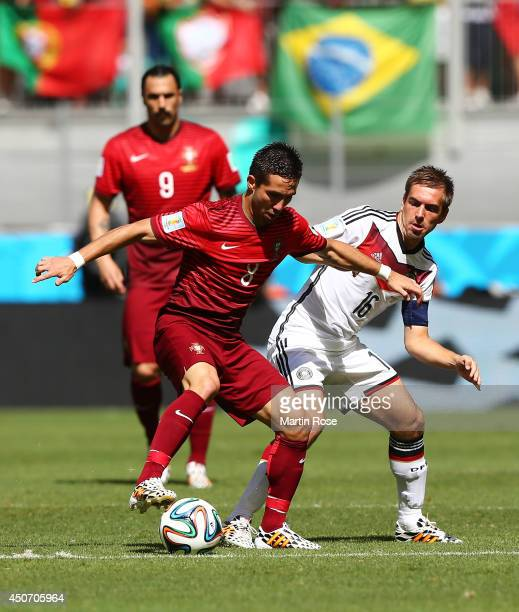Joao Moutinho of Portugal controls the ball against Philipp Lahm of Germany during the 2014 FIFA World Cup Brazil Group G match between Germany and...