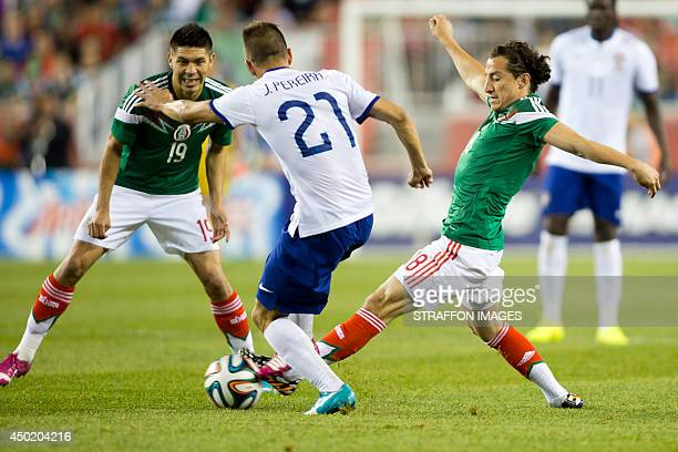 Joao Moutinho of Portugal fights for the ball with Oribe Peralta and Andres Guardado of Mexico during the Internatinal friendly match between Mexico...