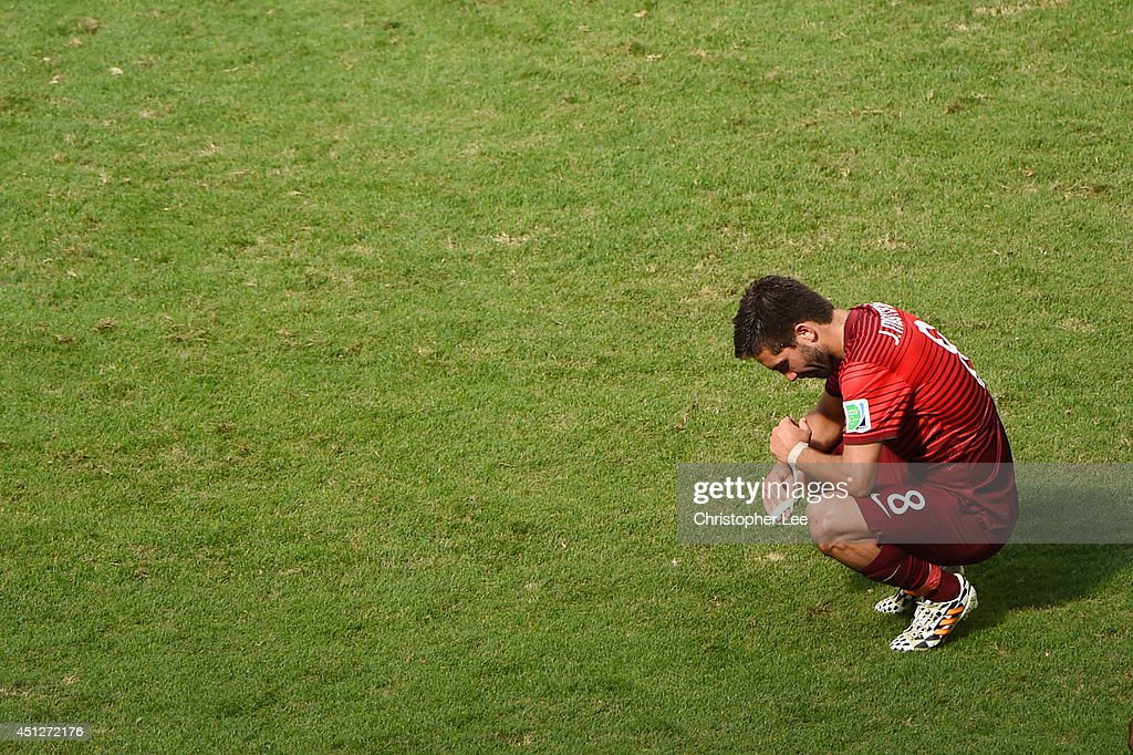 Joao Moutinho of Portugal looks dejected after the 2014 FIFA World Cup Brazil Group G match between Portugal and Ghana at Estadio Nacional on June 26...