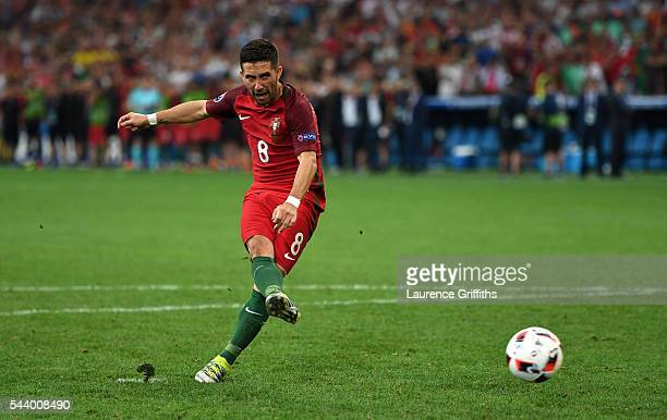 Joao Moutinho of Portugal scores at the penalty shootout during the UEFA EURO 2016 quarter final match between Poland and Portugal at Stade Velodrome...