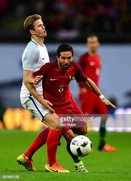 Joao Moutinho of Portugal takes on Eric Dier of England during the international friendly match between England and Portugal at Wembley Stadium on...