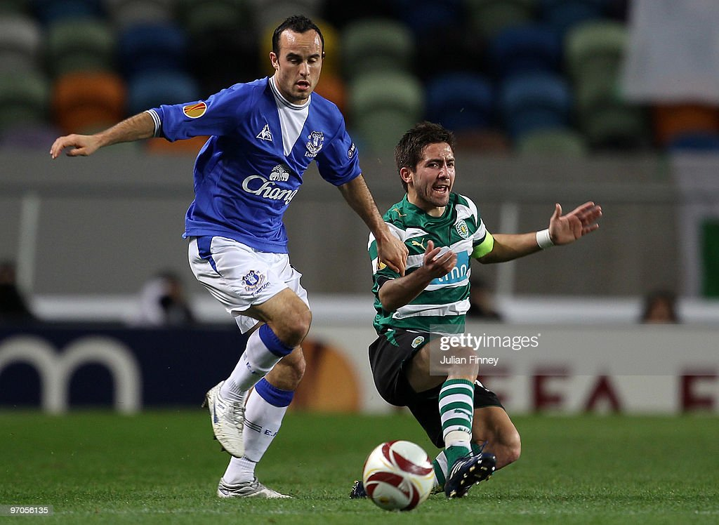 Joao Moutinho of Sporting battles with Landon Donovan of Everton during the UEFA Europa League Round of 32 2nd leg match between Sporting Lisbon and...