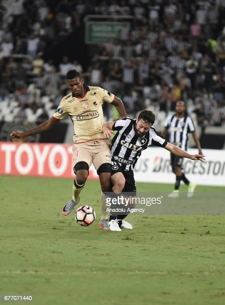 Joao Paulo Mior of Botafogo de Futebol e Regatas in action against Tito Valencia of Barcelona SC during Copa Libertadores of America match between...