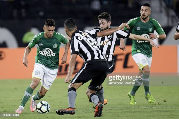 Joao Paulo of Botafogo battles for the ball with Alan Ruschel of Chapecoense during the match between Botafogo and Chapecoense as part of Brasileirao...