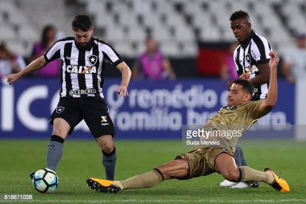 Joao Paulo of Botafogo struggles for the ball with Diego Souza of Sport Recife during a match between Botafogo and Sport Recife as part of...