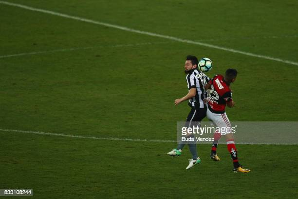 Joao Paulo of Botafogo struggles for the ball with Everton of Flamengo during a match between Botafogo and Flamengo as part of Copa do Brasil...