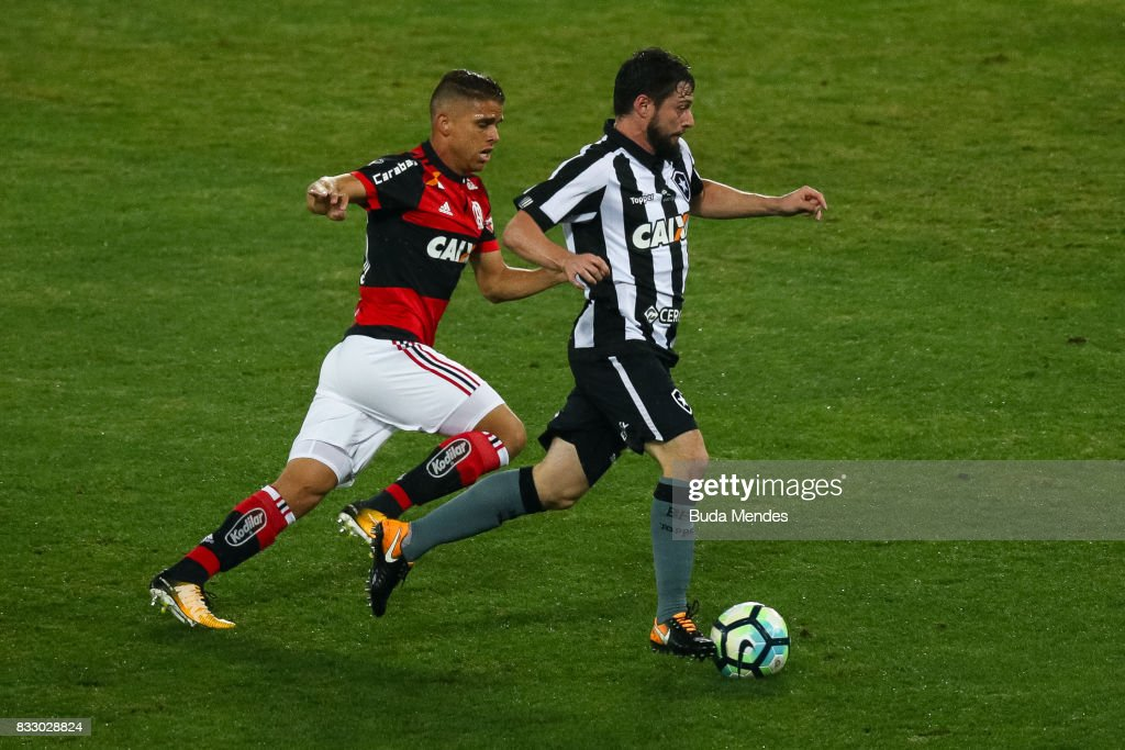 Joao Paulo (R) of Botafogo struggles for the ball with Gustavo Cullar of Flamengo during a match between Botafogo and Flamengo as part of Copa do Brasil Semifinals 2017 at Nilton Santos Olympic Stadium on August 16, 2017 in Rio de Janeiro, Brazil.