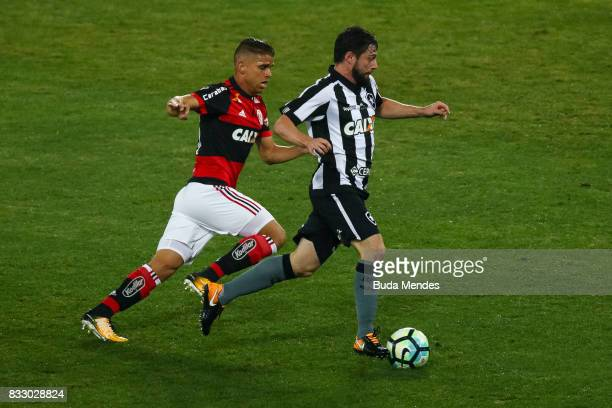 Joao Paulo of Botafogo struggles for the ball with Gustavo Cullar of Flamengo during a match between Botafogo and Flamengo as part of Copa do Brasil...