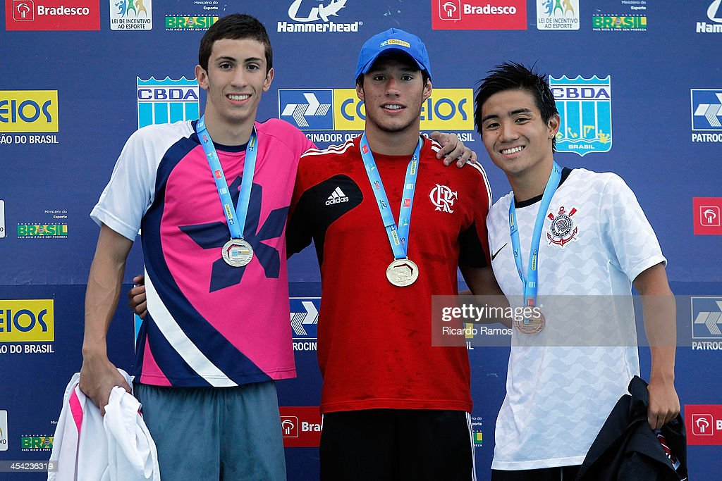 Joao Pedro Cervone, Luiz Altamir Lopes Melo and Yagoh Watanabe stands on the podium for boys 200m butterfly Junior 1 during Julio Delamare Trophy at Botafogo Aquatic Park on December 07, 2013 in Rio de Janeiro, Brazil.