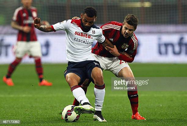 Joao Pedro Geraldino Dos Santos Galvao of Cagliari Calcio competes for the ball Marco Van Ginkel of AC Milan during the Serie A match between AC...