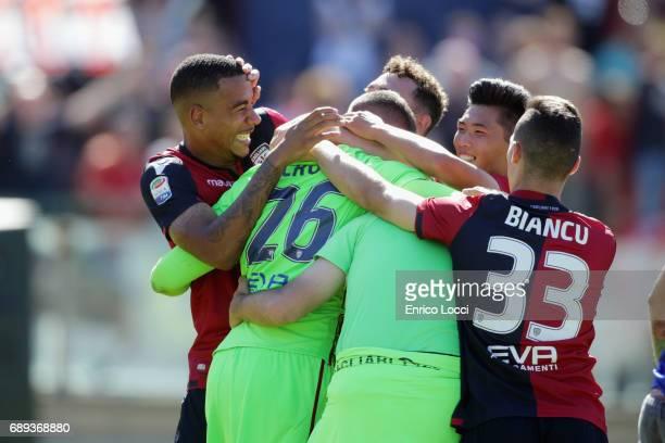 Joao Pedro Luca Crosta and Sean Miangue of Cagliari celebrates his goal during the Serie A match between Cagliari Calcio and AC Milan at Stadio...