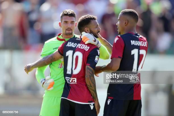 Joao Pedro Luca Crosta and Sean Miangue of Cagliari celebrates the winner during the Serie A match between Cagliari Calcio and AC Milan at Stadio...