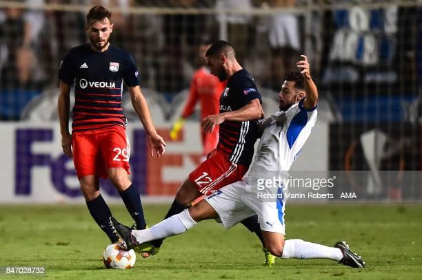 Joao Pedro of Apollon Limassol tackles Jordan Ferri of Olympique Lyonnais during the UEFA Europa League group E match between Apollon Limassol and...