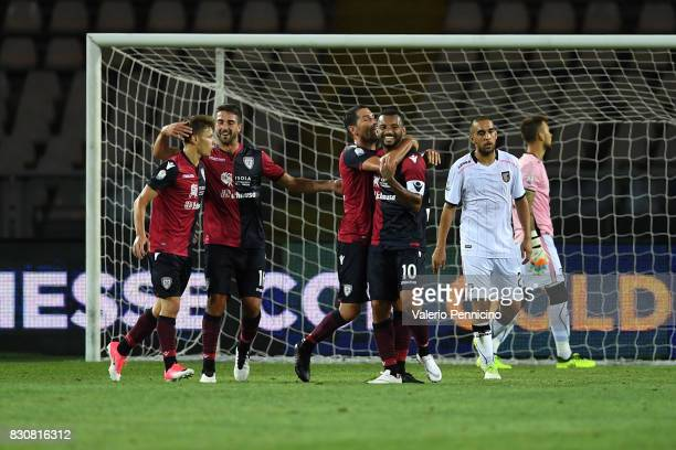 Joao Pedro of Cagliari Calcio celebrates after scoring the opening goal with team mates during the TIM Cup match between Cagliari Calcio and US Citta...