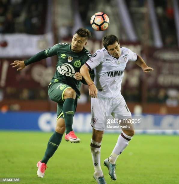 Joao Pedro of Chapecoense and Alejandro Silva of Lanus go for a header during a group stage match between Lanus and Chapecoense as part of Copa...